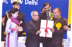 Mr. J.L. Kaul receiving the Best Braille Press Award from the President of India on 6th February, 2013