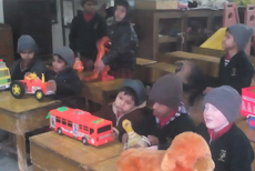 children of nursery class learning in touch and tell museum