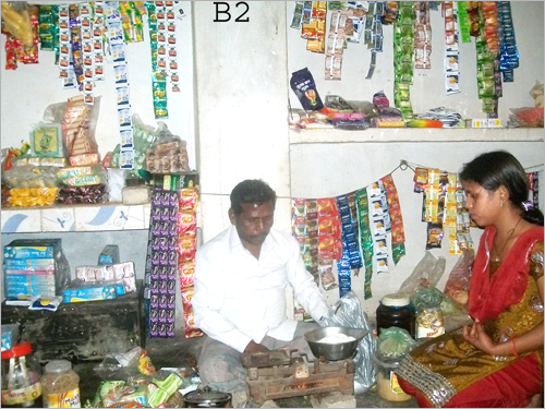 Graphic: Ram Lakhan weighing his product in the store