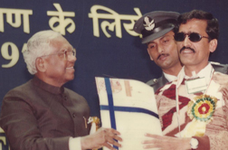 Brij Mohan Acharya, receiving  Best Employee National Award  from President of India