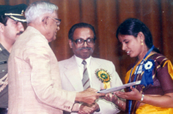 Selvi R, receiving Best Employee National Award from President of India
