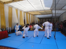 School students displaying Judo skills