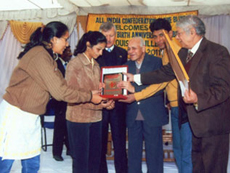 Ms. Zarana Dilipkumar Maheshwary receiving Krishan Kumari Varma Memorial award for topping the University in her subject at a public function organized by All India Confederation of the Blind on the occasion of 202nd Birth Anniversary of Louis Braille